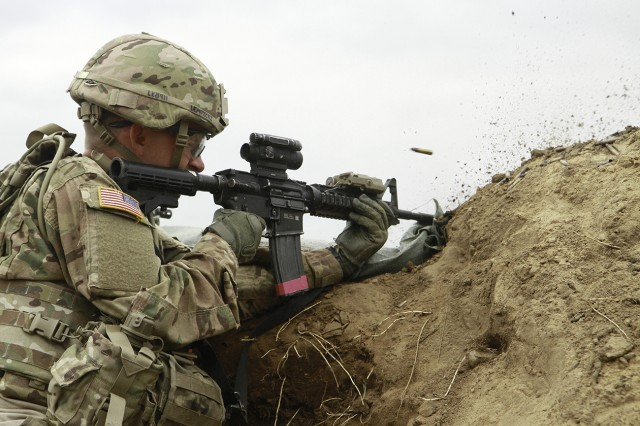 Spc. Jacob Lempicky, combat engineer, suppresses a simulated enemy during the exercise. The training focused on the skills needed to secure, build and defend an area suitable for sustained engineering operations. It parallels current mission taskings for the Soldiers' upcoming deployment to Afghanistan.