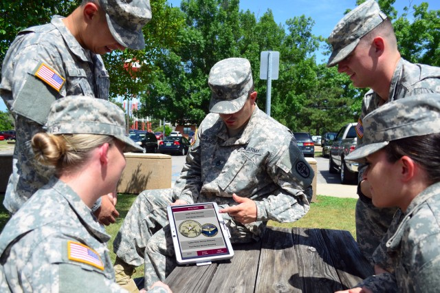 Soldiers, at Lyster Army Health Clinic, utilize the new mobile health app for Fort Rucker, Ala. The app can be used to find useful links and contact information for various places of interest on Fort Rucker, as well as events happening on post.