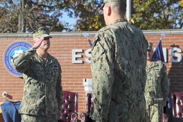 Navy Lt. Brian Wood, left, newly assigned officer in charge of the Equipment Operator and Engineering Aide School and Prime Power School for Mobile Utilities Support Equipment training, salutes Navy Capt. Glenn Hubbard, commanding officer for Fort Leonard Wood's Center for Seabees and Facilities Engineering Detachment.