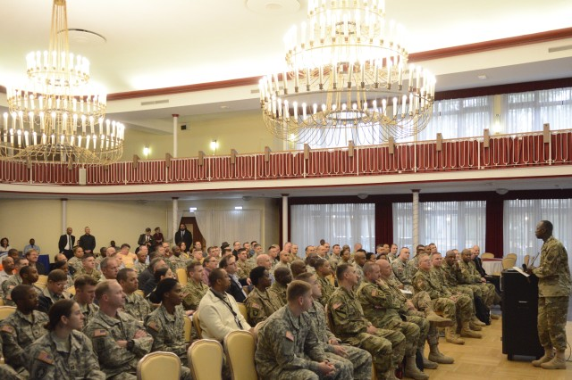 Col. Jimmy L. Hall Jr., commander of 5th Signal Command and the U.S. Army Europe chief information officer/G6, speaks to more than 100 Army and Air Force signal Soldiers and civilians at the U.S. Army Garrison Rheinland-Pfalz Orange Call Oct. 21 at the Armstrong's Club in Kaiserslautern. (U.S. Army photo by William B. King, 5th Signal Command Public Affairs/Released)