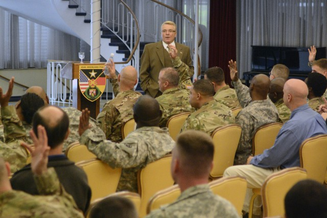Dan Hingtgen, from the U.S. Army Europe G6 Cybersecurity Division, gives a presentation about cybersecurity awareness at the U.S. Army Garrison Rheinland-Pfalz Orange Call Oct. 21 at the Armstrong's Club in Kaiserslautern. (U.S. Army photo by William B. King, 5th Signal Command Public Affairs/Released)