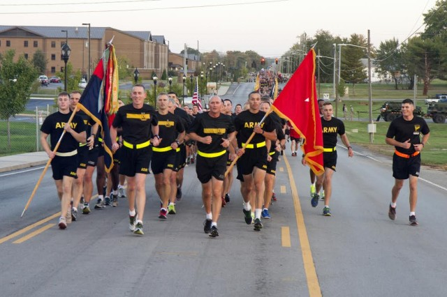 Major Gen. Gary J. Volesky, commanding general, 101st Airborne Division and Fort Campbell, and Sgt. Maj. Richard Black, operations sergeant major for the 101st, lead the division during the Run for the Fallen, Oct. 16, 2015. Nearly 22,000 Soldiers ran with Gold Star Families to honor fallen service members.