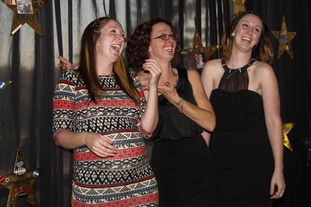 Sisters Ashley Romero, Jamie Hayes and Kali Hayes, daughters of the late Master Sgt. James Frederick Hayes, share a laugh during the Commanding General's Reception and Surviving Family Dance, Oct. 17, 2015. The event was part of Fort Campbell's Military Survivor Appreciation Week, Oct. 15-18, 2015.