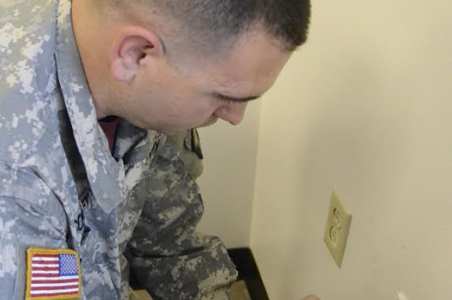 Sgt. Dustin Conley, Alfred V. Rascon School of Combat Medicine, secures an outlet cover at the facility. Conley's efforts as a Facility Maintenance Technician were recognized Friday with a $30,000 Facility Maintenance Incentive Program first-place award in the small-unit category.