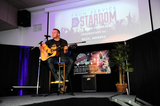 PRESIDIO OF MONTEREY, Calif. -- Lance Cpl. Todd Theobald, Marine Corps Detachment Monterey, displays his musical talents during the Presidio's 2015 Rising Star competition finals held here at the Hobson Recreation Center, Sept. 25.