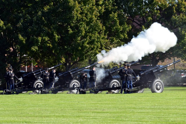 The Presidential Salute Battery fires a 19-gun salute for Army Secretary John M. McHugh on Joint Base Myer-Henderson Hall, Va., Oct. 23, 2015, during a farewell tribute to McHugh.