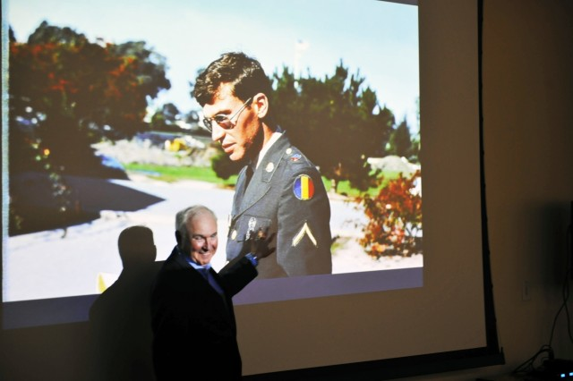 Maj. Gen. James A. Adkins, a 1976 Defense Language Institute Foreign Language Center graduate in Russian, points to a photo of himself as a student. Adkins spoke to current Russian students at the institute's European and Latin American School Oct. 23.