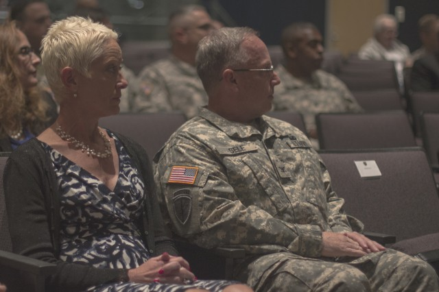 Brig. Gen. Richard Sele, 108th Training Command (IET) deputy commanding general, waits patiently with his wife, Mary, before being promoted to general officer during a ceremony hosted by Maj. Gen. Daniel Ammerman, United States Army Civil Affairs and Pychological Operations Command commanding general, at the Airborne and Special Operations Museum in Fayetteville, N.C., Oct. 25, 2015. Sele, a longtime civil affairs Soldier, takes over for Brig. Gen. A. Ray Royalty as the deputy commanding general of the 108th, headquartered in Charlotte, N.C. (U.S. Army photo by Sgt. 1st Class Brian Hamilton)