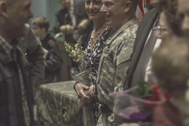 Brig. Gen. Richard Sele, 108th Training Command (IET) deputy commanding general, greets family and friends with his wife, Mary, after being promoted to general officer during a ceremony hosted by Maj. Gen. Daniel Ammerman, United States Army Civil Affairs and Pychological Operations Command commanding general, at the Airborne and Special Operations Museum in Fayetteville, N.C., Oct. 25, 2015. Sele, a longtime civil affairs Soldier, takes over for Brig. Gen. A. Ray Royalty as the deputy commanding general of the 108th, headquartered in Charlotte, N.C. (U.S. Army photo by Sgt. 1st Class Brian Hamilton)