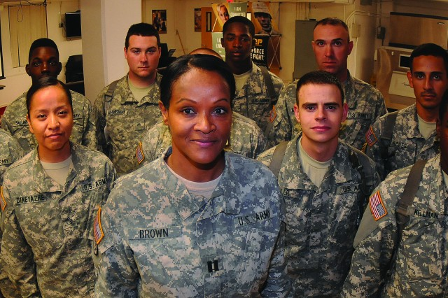 Capt. Rolona Brown, commander of Echo Company, 266th Quartermaster Battalion, on Joint Base Langley-Eustis, Va., stands with advanced individual training Soldiers assigned to her unit.