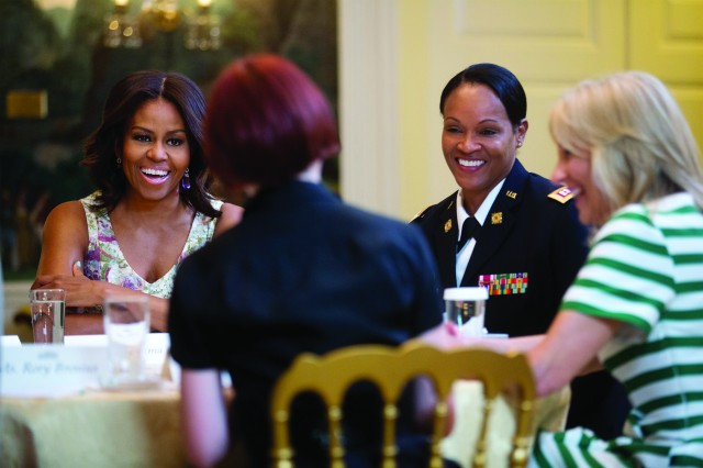 First lady Michelle Obama and Dr. Jill Biden, wife of Vice President Joe Biden, participate in a Joining Forces roundtable discussion with military-connected women at the White House, May 8, 2015.