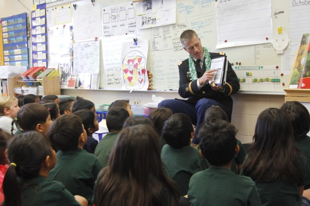 "Lt. Col. Dustin Bishop, an information technology officer in the 8th Theater Sustainment Command, talks to first grade students about the importance of staying true to their values at Mililani 'Ike Elementary School, Mililani, Hawaii, Oct. 21, 2015. ""Children are never too young to plant the seeds of success"" said Bishop. ""If we immerse children in an environment where choosing higher education and setting goals toward establishing careers seems normal, they stand a far greater chance of successfully navigating the perils of teenage years, and finding themselves on glide paths envisioned years earlier."""