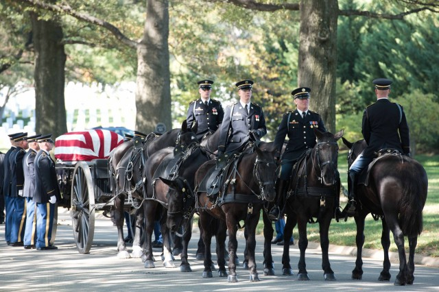 Soldiers of the 3rd U.S. Infantry Regiment (The Old Guard) conduct a full military honors burial for Army Maj. Dale W. Richardson, 28, of Mount Sterling, Ill.; Staff Sgt. Bunyan D. Price Jr., 20, of Monroe, N.C.; and Sgt. Rodney L. Griffin, 21, of Mexico, Mo., buried within a single casket of group remains Oct. 20, 2015, in Arlington National Cemetery. The three Soldiers went missing in Vietnam when their UH-1H Iroquois (Huey) helicopter was shot down after being diverted by bad weather to Cambodian airspace. Richardson, Price, and Griffin died at the site of the crash during a firefight with enemy forces. All three soldiers were identified by circumstantial evidence and forensic identification tools, to include mitochondrial DNA, matched with their siblings. (U.S. Army photo by Spc. Brandon C. Dyer)