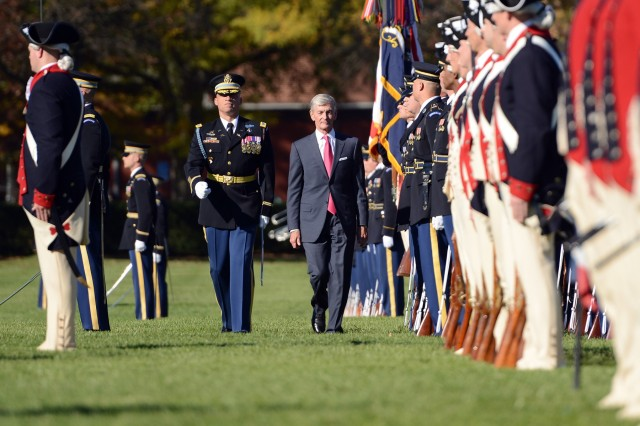Army Secretary John M. McHugh, right, and U.S. Army Col. Johnny K. Davis, commander of troops, inspect the troops during a Army Full Honors Farewell Ceremony for McHugh on Summerall Field at the Fort Myer portion of Joint Base Myer-Henderson Hall Oct. 23. McHugh was secretary of the Army for six years. (Photo by C. Todd Lopez)