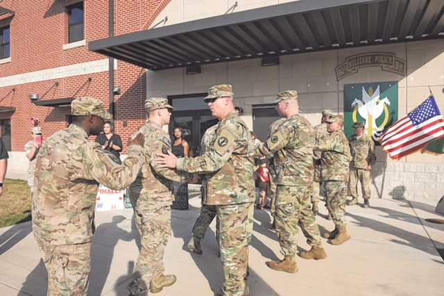 Ten 13th Military Police Company, 92nd Military Police Battalion Soldiers are greeted by fellow Soldiers and Family members during a redeployment ceremony held at the 92nd MP Bn. headquarters, Oct. 22.
