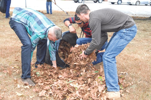 From left, Marine Pvt. Justin London, Marine Pfc. Octavio Solorio and 2nd Lt. Andrew Rotermund, work together to bag leaves Saturday at Soldier Memorial Chapel on Make a Difference Day.