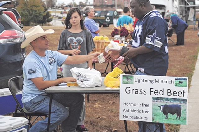 John Myers, a local grass-fed beef rancher, completes a sale with a patron at the final Fort Leonard Wood Farmers' Market, Friday at the Morale, Welfare and Recreation Rec Plex. The regular vendors were on site at the last market of the season, plus Myers was one of the vendors who donated product to be cooked and handed out free to visitors wanting to taste before purchasing.