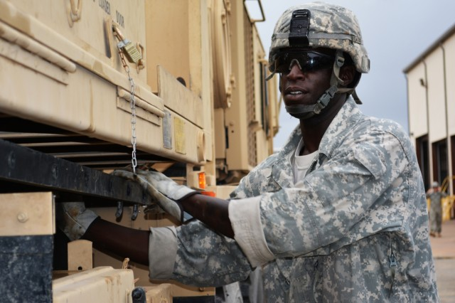 Sgt. Julius Anderson, motor sergeant 546th Area Support Medical Company, grabs the ladder from a tow truck during the Wheeled Vehicle Recovery Course at Regional Training Site Maintenance-Fort Hood, Texas, Oct. 22, 2015. The course teaches Army mechanics how to properly and safely recover and tow vehicles that may be stuck or inoperable.