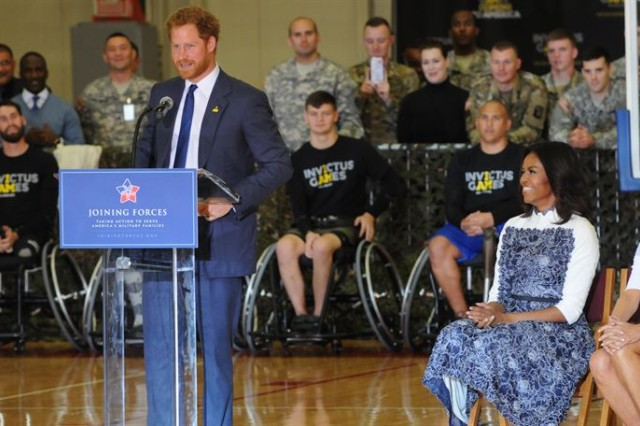 Britain's Prince Harry talks to wounded warriors on Fort Belvoir, Va., alongside first lady Michelle Obama and Dr. Jill Biden, as they officially launch the second Invictus Games, Oct. 28, 2015. The games are set to be held in Orlando, Fla., in May.