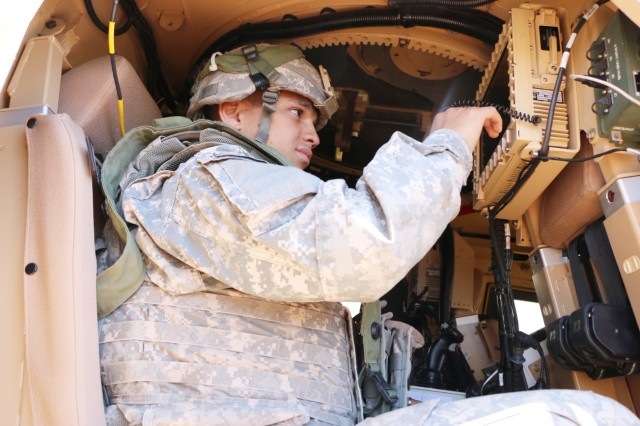A Soldier operates a single display unit system inside a mine-resistant, ambush-protected all-terrain vehicle during Network Integration Evaluation 15.2 on Fort Bliss, Texas.