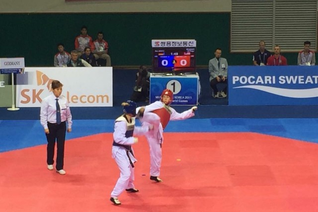 Capt. Jessica H. Tackaberry, the public affairs officer for the 2nd Combat Aviation Brigade and a native of Missoula, Montana, competes in taekwondo on October 9 at the 2015 World Military Games in Mungyeong, South Korea.