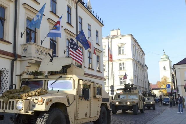 Paratroopers from Company D, 1st Battalion, 503rd Infantry Regiment, 173rd Airborne Brigade, roll into Rzeszow, Poland, Oct. 27, 2015, for a community engagement during day four of Operation Bayonet Thrust, the multinational road march bringing them home to Italy after a five-month rotation in Lithuania in support of Operation Atlantic Resolve. (U.S. Army photo by Sgt. A.M. LaVey)