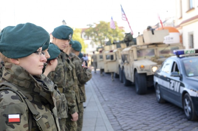 Polish army cadets provide an honor guard for paratroopers from Company D, 1st Battalion, 503rd Infantry Regiment, 173rd Airborne Brigade after the paratroopers met with schoolchildren and members of the public in Rzeszow, Poland, Oct. 27, 2015, during day four of Operation Bayonet Thrust, the multinational road march bringing them home to Italy after a five-month rotation in Lithuania in support of Operation Atlantic Resolve. (U.S. Army photo by Sgt. A.M. LaVey)