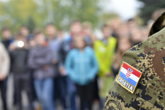 Paratroopers from the 173rd Airborne Brigade and Croatian soldiers from the 1st Mechanized Battalion, meet with schoolchildren in Petrinja, Croatia, during Operation Bayonet Thrust, a multinational convoy bringing the Americans home to Italy after five month training in Lithuania as part of Operation Atlantic Resolve. (U.S. Army photo by Sgt. A.M. LaVey/173rd ABN PAO)