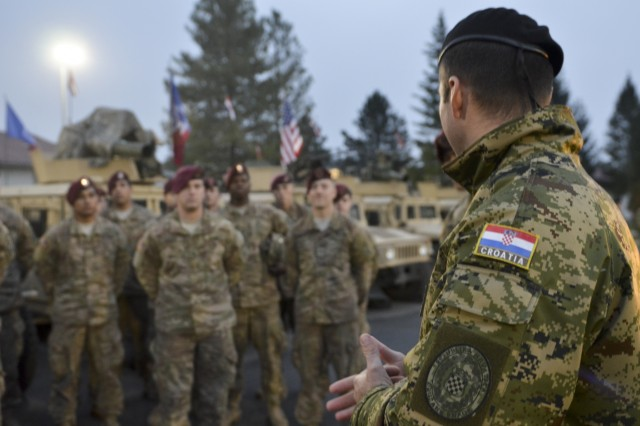 Croatian Maj. Zdenko Fiala the commander of the 1st Mechanized Battalion, speaks with paratroopers from the 173rd Airborne Brigade and Croatian soldiers in Petrinja, Croatia, Oct. 29, during Operation Bayonet Thrust, a multinational convoy bringing the Americans home to Italy after five month training in Lithuania as part of Operation Atlantic Resolve. (U.S. Army photo by Sgt. A.M. LaVey/173rd ABN PAO)