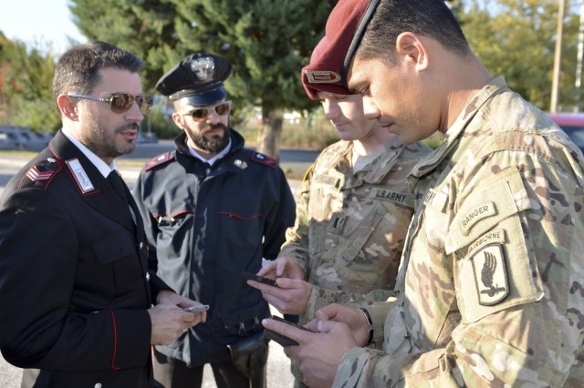 U.S. Army Capt. Helaman Fepuleai, commander, Company D, 1st Battalion, 503rd Infantry Regiment, 173rd Airborne Brigade, speaks with Italian carabinieri near Gorizia, Italy, Oct. 30, 2015, during the second day of ‪Operation Bayonet Thrust‬, a multinational convoy bringing the Americans home to Italy after five-month training in Lithuania as part of Operation Atlantic Resolve. (U.S. Army photo by Sgt. A.M. LaVey/173rd ABN PAO)