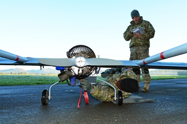 Sgt. Desmond Herring, a U.S. paratrooper assigned to the Company D, 54th Brigade Engineer Battalion, 173rd Airborne Brigade, conducts pre-flight checks on an RQ7B Shadow Technical unmanned aircraft system at Aeroclub Postonja in Slovenia, Oct. 20, 2015, during Exercise Rock Proof V.