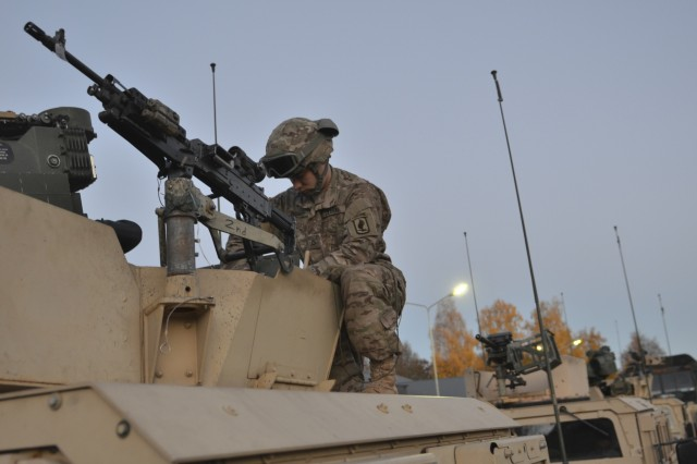 A U.S. Army paratroopers from Company D, 1st Battalion, 503rd Infantry Regiment, 173rd Airborne Brigade, prepares his vehicle on day one of Operation Bayonet Thrust, in Panevezys, Lithuania, Oct. 24, 2015. Bayonet Thrust is name of the multinational convoy bringing the 173rd home from a rotation in the Baltics in support of Operation Atlantic Resolve. (U.S. Army photo by Sgt. A.M. LaVey/173 ABN PAO)