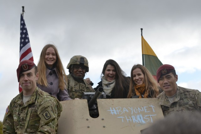 Lithuanian citizens pose with paratroopers from Company D, 1st Battalion, 503rd Infantry Regiment, 173rd Airborne Brigade, during a community event on day one of Operation Bayonet Thrust, Vilnius, Lithuania, Oct. 24, 2015. Bayonet Thrust is name of the multinational convoy bringing the 173rd home from a rotation in the Baltics in support of Operation Atlantic Resolve. (U.S. Army photo by Sgt. A.M. LaVey/173 ABN PAO)