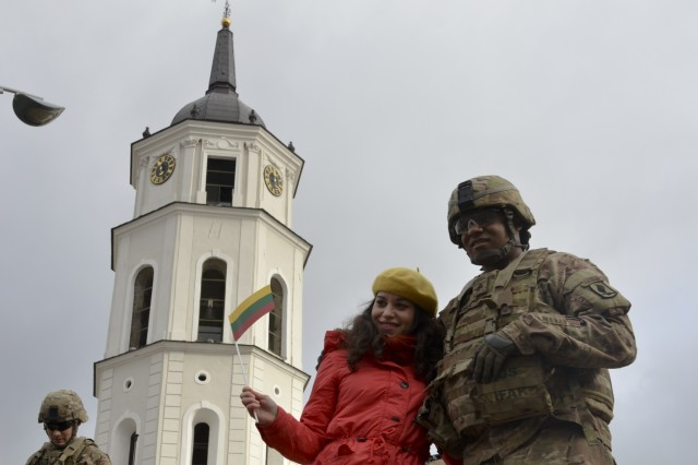 Maria Rosaria, an Italian tourist, poses with Sgt. Terrence McGee, a healthcare specialist from Company D, 1st Battalion, 503rd Infantry Regiment, 173rd Airborne Brigade, during a community event on day one of Operation Bayonet Thrust, Vilnius, Lithuania, Oct. 24, 2015. Bayonet Thrust is name of the multinational convoy bringing the 173rd home from a rotation in the Baltics in support of Operation Atlantic Resolve. (U.S. Army photo by Sgt. A.M. LaVey/173 ABN PAO)