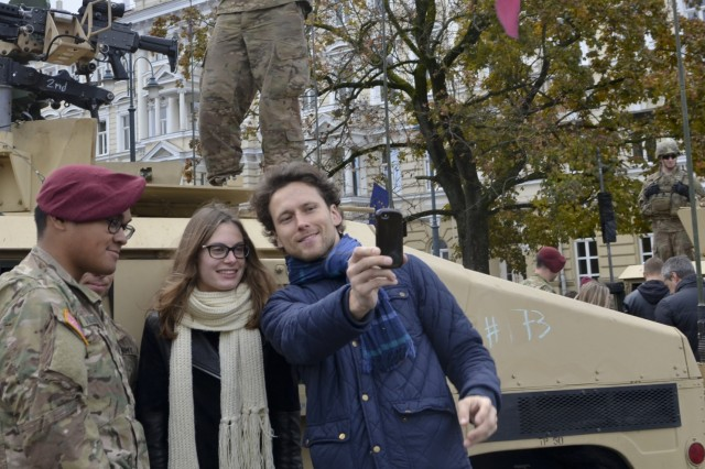 Vilnius residents pose with paratroopers from Company D, 1st Battalion, 503rd Infantry Regiment, 173rd Airborne Brigade, during a community event on day one of Operation Bayonet Thrust, Vilnius, Lithuania, Oct. 24, 2015. Bayonet Thrust is name of the multinational convoy bringing the 173rd home from a rotation in the Baltics in support of Operation Atlantic Resolve. (U.S. Army photo by Sgt. A.M. LaVey/173 ABN PAO)