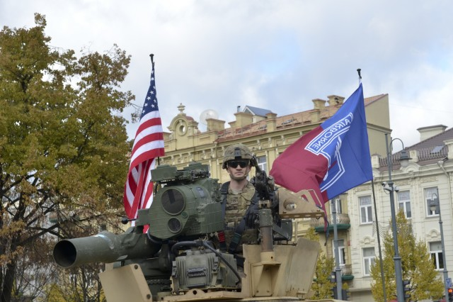 A paratrooper from Company D, 1st Battalion, 503rd Infantry Regiment, 173rd Airborne Brigade, mans the hatch following a community event on day one of Operation Bayonet Thrust, Vilnius, Lithuania, Oct. 24, 2015. Bayonet Thrust is name of the multinational convoy bringing the 173rd home from a rotation in the Baltics in support of Operation Atlantic Resolve. (U.S. Army photo by Sgt. A.M. LaVey/173 ABN PAO)