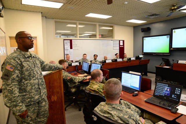 Master Sgt. Forte L. Cunningham facilitates a practical exercise during the 15-day Master leader Course pilot class. The Master leaders Course consists of topics such as Army and Joint Doctrine; Interagency Capabilities and Considerations; Plans, Orders and Annexes; Decisive Action; Military Justice Rules and Procedures; Command Inspection program; Servant leadership; Personnel Readiness; Military Decision Making Process; Public Speaking; Military Briefings and Writing. (U.S. Army photo by David Crozier)