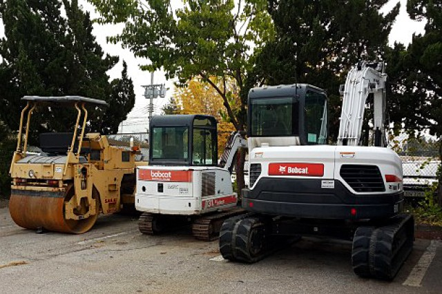 Special purpose equipment sits ready to be transferred to the Department of Public Works at Camp Red Cloud, Republic of Korea. (Photo by Michael Lee, LRC-RC)