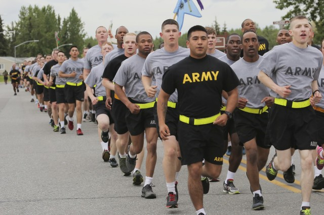 Black socks are now authorized for wear with both the Improved Physical Fitness Uniform (black and gold) and the traditional gray Army Physical Fitness Uniform. Both uniforms are shown here a U.S. Army Alaska formation as Soldiers participate in an Army Birthday Run on Joint Base Elmendorf-Richardson, Alaska, June 4, 2015.