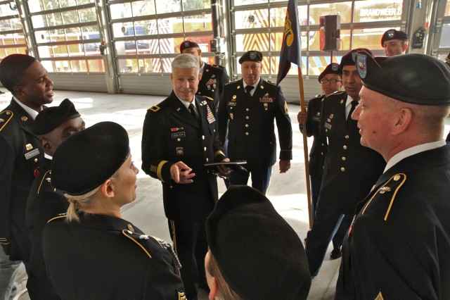 Brig. Gen. Arlan DeBlieck, commanding general of the 7th Mission Support Command, speaks to Soldiers from the 773rd Civil Support Team and Belgian firefighters from Hulpverlenings Zone Vlaams-Brabant West after the 773rd change of command ceremony Oct. 30, 2015 in Halle, Belgium. (Photo by Staff Sgt. Rick Scavetta, 7th Mission Support Command public affairs office)