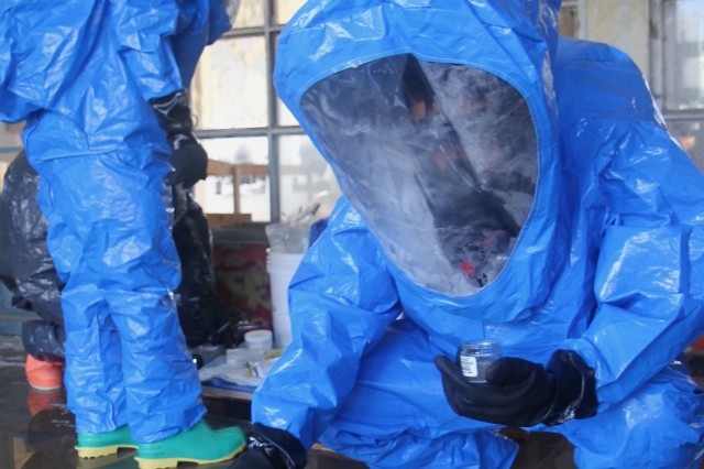 RELEGEM, Belgium - Soldiers from the 773rd Civil Support Team employ sophisticated gear to determine contaminants during a hazardous material scenario at CBRN Week 2015. (Photo by Staff. Sgt. Rick Scavetta, 7th Mission Support Command)
