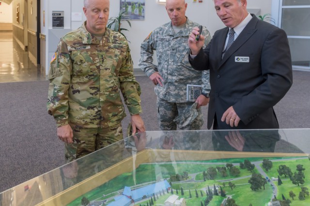 "Dan Arden, Incident Response Training Department director, right, explains the various components of the Lt. Terry Facility to Lt. Gen. Kevin Mangum, U.S. Army Training and Doctrine Command deputy commanding general and chief of staff, as Col. Scott Kimmell, Chemical, Biological, Radiological and Nuclear School assistant commandant, looks on during Mangum's tour of the facility. Mangum observed various training and sites on Fort Leonard Wood during his visit to the installation Oct. 27 and 28. ""I was surprised and impressed with the numerous complex missions including multi-compo and interservice training at Fort Leonard Wood. The post provides critical maneuver support capabilities — unique skills and tools — needed by supported commanders and does so with great efficiency,"" Mangum said."