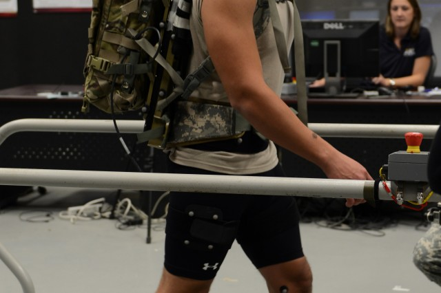 Pfc. Kenneth Blandon tries out the Energy Harvesting Backpack, wearing special sensors that pick up body motion from near-infrared cameras.