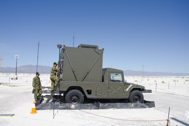 A pair of Japanese Ground Self Defense Force members climb into the command vehicle for ChuSAM Kai at the Tac-2 launch area during the test of the system. The command vehicles are similar in design to American Humvees.