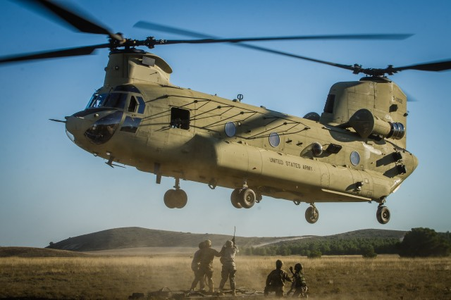 Soldiers, from partner nations, practice hooking a slingload to a CH-47F Chinook helicopter, from Hotel company, 1st Battalion, 214th Aviation Regiment, 12th Combat Aviation Brigade, as part of NATO Exercise Trident Juncture 2015 in Zaragoza, Spain. (U.S. Army photo by Spc. Chase Geiger)