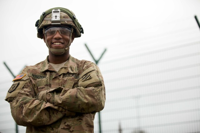 Sgt. Charles Roseboro prepares to perform preventive maintenance checks and services with his comrade during Exercise Combined Resolve V at the Joint Multinational Readiness Center in Hohenfels, Germany, Nov. 7, 2015.