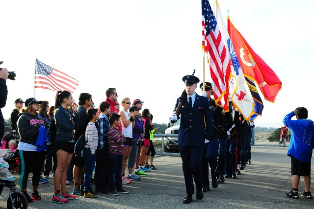 PRESIDIO OF MONTEREY, Calif. -- The Honor Joint Service Color Guard from the Defense Language Institute Foreign Language Center parade the colors during the ceremony prior to the third annual Honor Our Fallen 5k & 10K Run/Walk event, Oct. 24