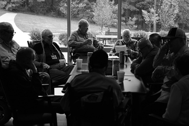 Every other Saturday, a group of veterans meets at the Armed Forces Retirement Home in Washington, D.C., to swap stories about war, peace and everything in between. Counterclockwise, from bottom middle: Ed Davis (in wheelchair), Stan Stewart, William Fowler, William J. Opferman, Robert M. Webb, Joe Nesnow, Esker McConnell, William J. Morgan, Ernest L. Janes and AFRH librarian Christine Baldwin.