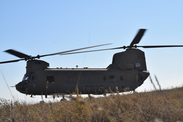 A U.S. Army UH-47 Chinook, prepares for take off, Oct. 30, 2015, during a combined exercise known as Trident Juncture in Chinchilla, Spain. The 173rd Airborne Brigade is the U.S. Army Contingency Response Force in Europe and is capable of deploying ready forces to conduct the full range of military operations across the U.S. European, Africa and Central Commands' areas of operations within 18 hours. (U.S. Army photo by 2nd Lt. Richard Hinman)
