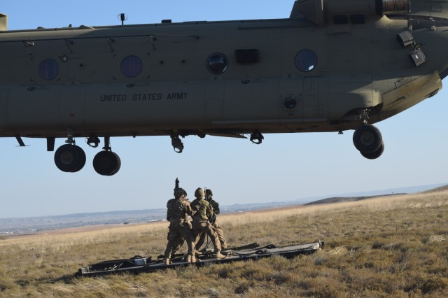Soldiers from the U.S. Army 173rd Airborne Brigade along with 8th Battalion Spanish Legion Brigade,secure a pallet to a CH-47 Chinook, Oct. 30, 2015, during a combined exercise known as Trident Juncture in Chinchilla, Spain. The 173rd Airborne Brigade is the U.S. Army Contingency Response Force in Europe and is capable of deploying ready forces to conduct the full range of military operations across the U.S. European, Africa and Central Commands' areas of operations within 18 hours. (U.S. Army photo by 2nd Lt. Richard Hinman)